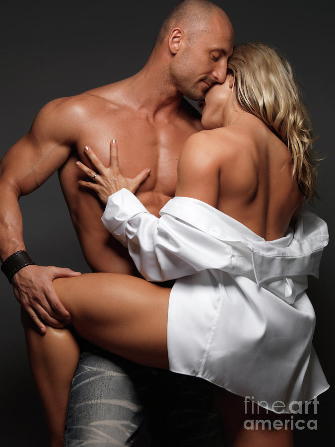 Woman Embracing A Muscular Man Photograph By Maxim Images -4303
