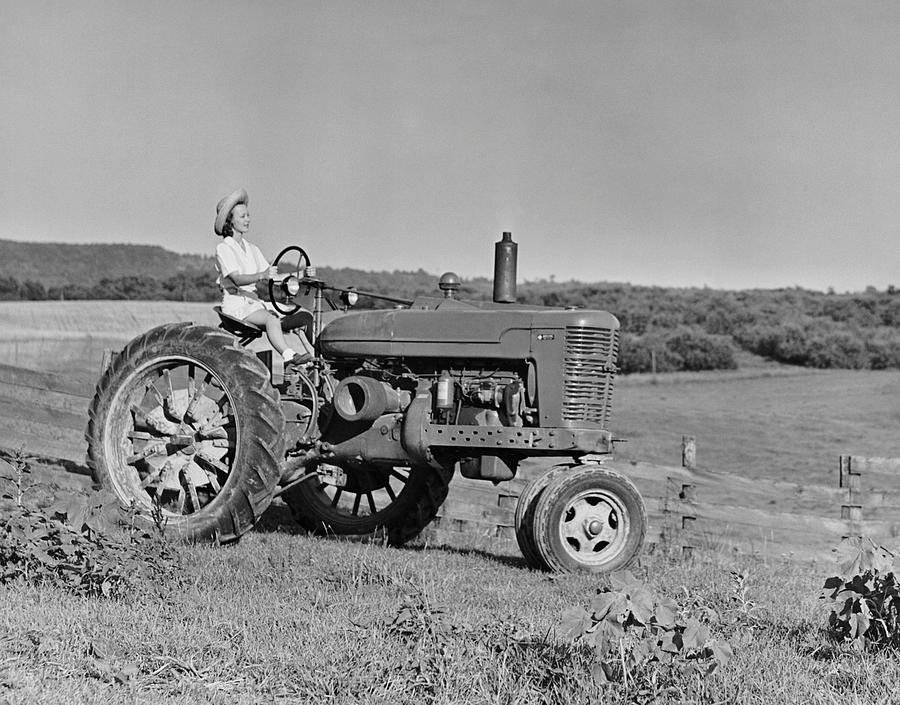 Adult Photograph - Woman Farmer Driving Tractor by George Marks