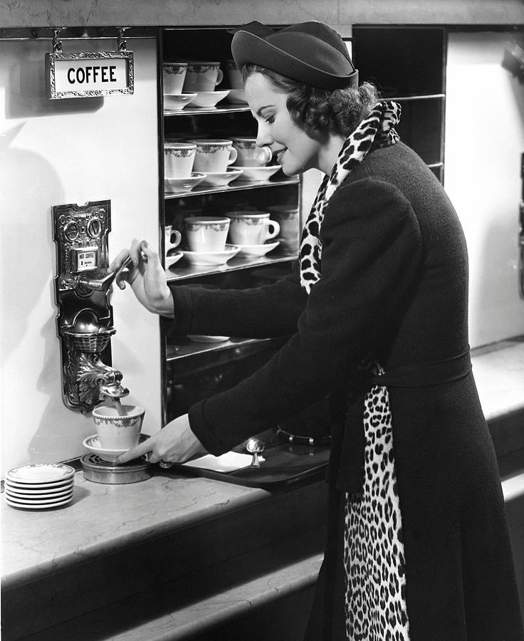 Adult Photograph - Woman Getting Coffee At Old Fashioned Machine by George Marks