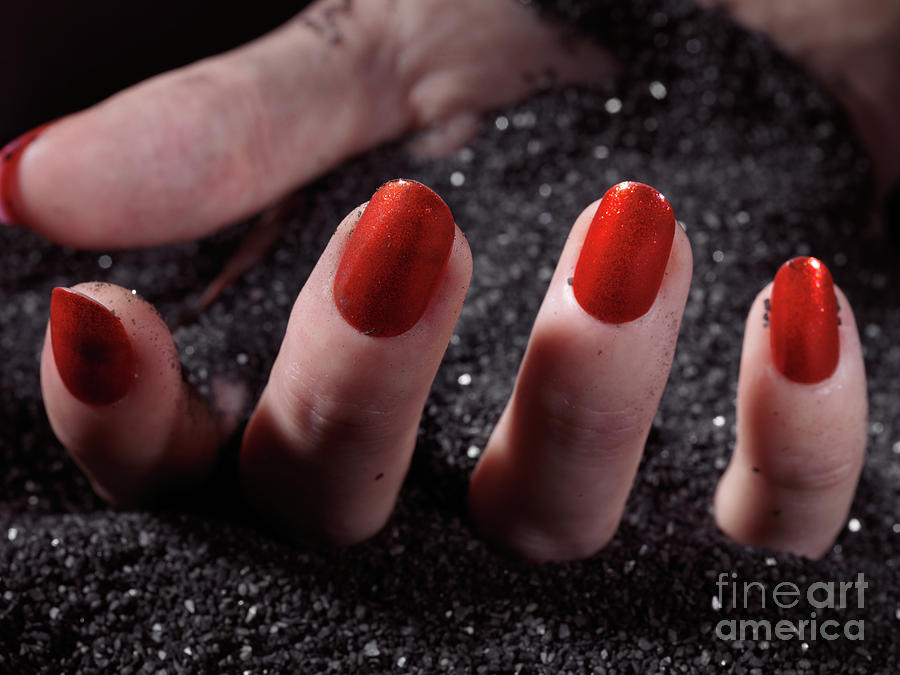 Manicure Photograph - Woman Hand With Red Nail Polish Buried In Black Sand by Oleksiy Maksymenko