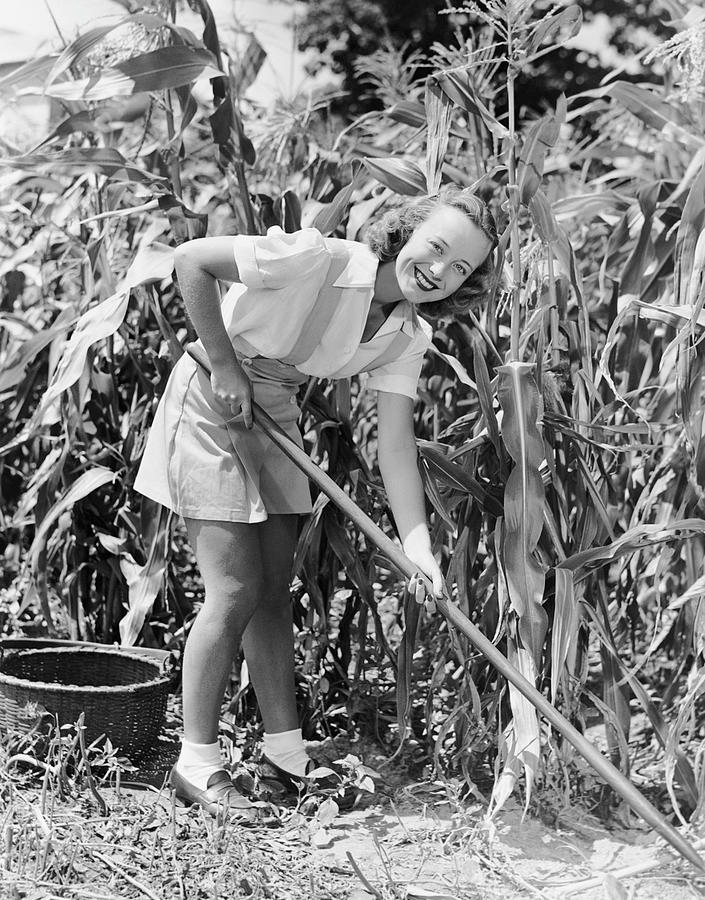 Adult Photograph - Woman Hoeing In Field Of Corn by George Marks