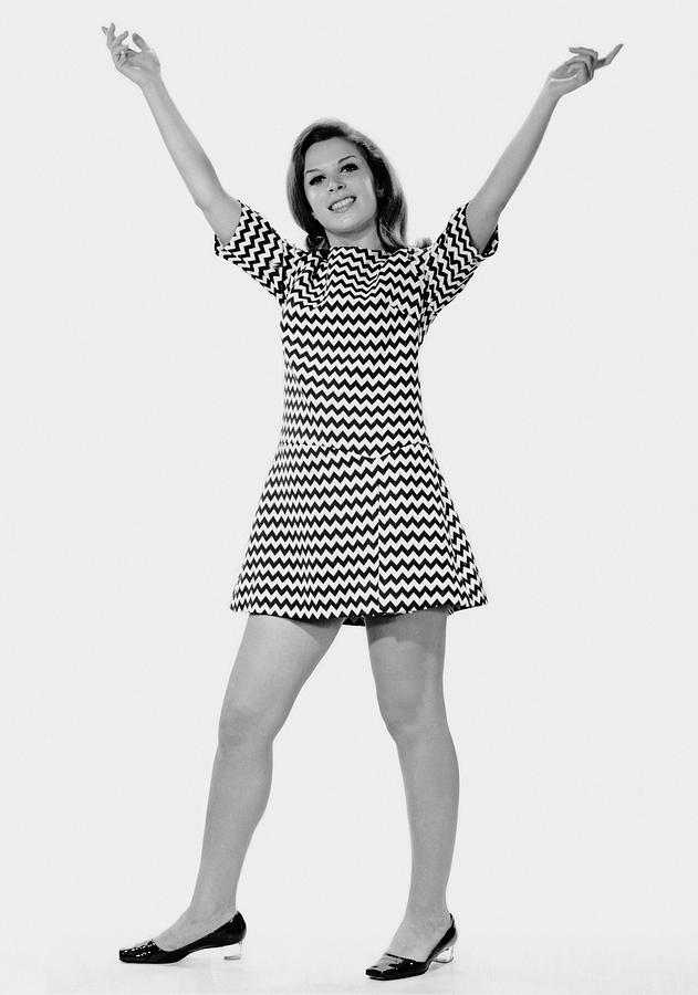 Adult Photograph - Woman Holding Arms Up In The Air by George Marks