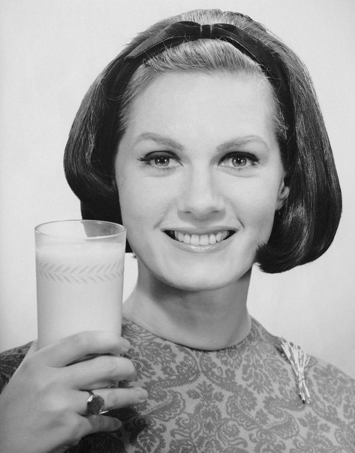 Adult Photograph - Woman Holding Glass Of Milk by George Marks
