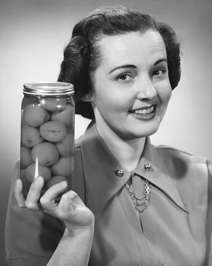 Adult Photograph - Woman Holding Jar Of Fruit by George Marks