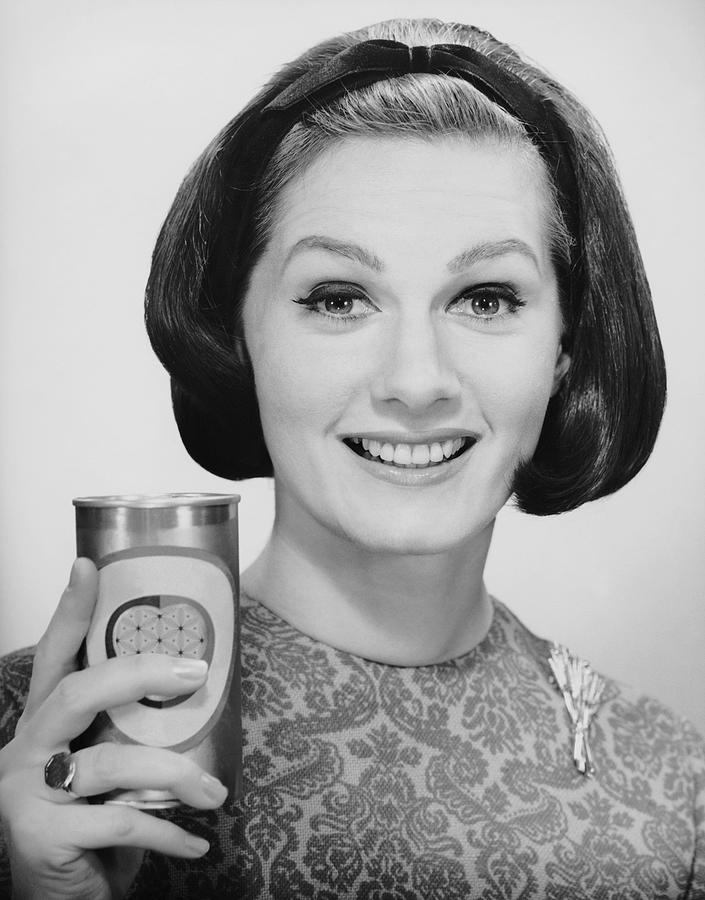 Adult Photograph - Woman Holding Up Can Of Beer by George Marks