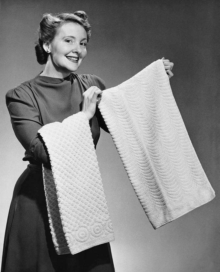 Adult Photograph - Woman Holding Up Towels by George Marks