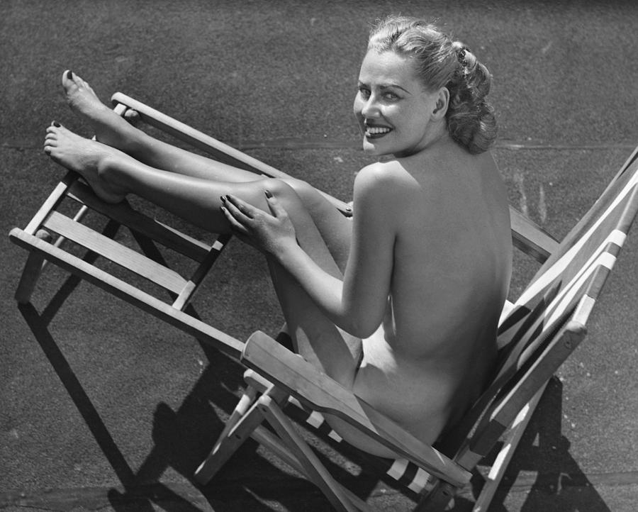 Adult Photograph - Woman In Beach Chair by George Marks