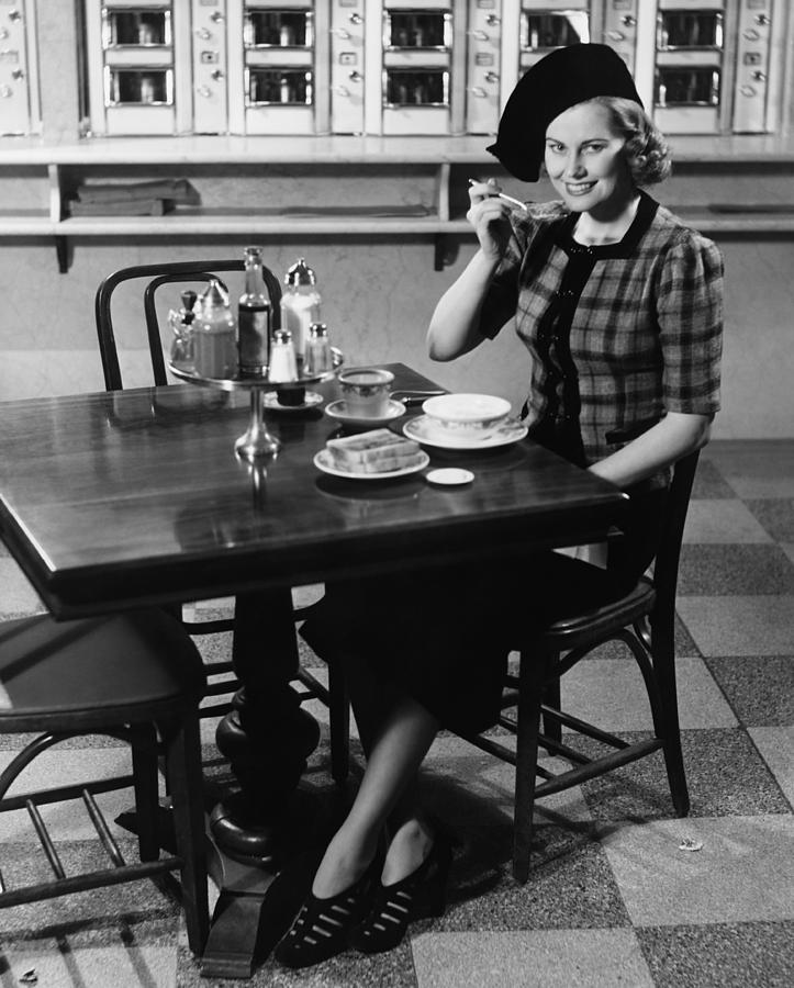 Adult Photograph - Woman In Fancy Hat Eating Breakfast In Bar, (b&w), Portrait by George Marks