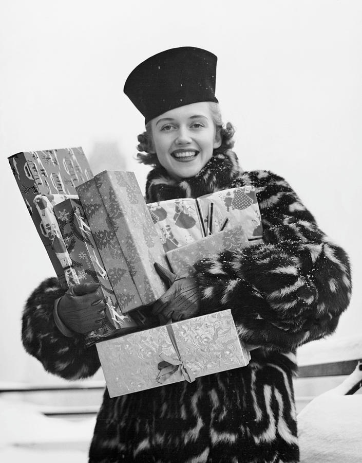 Adult Photograph - Woman In Fur Coat Holding Christmas Gifts by George Marks