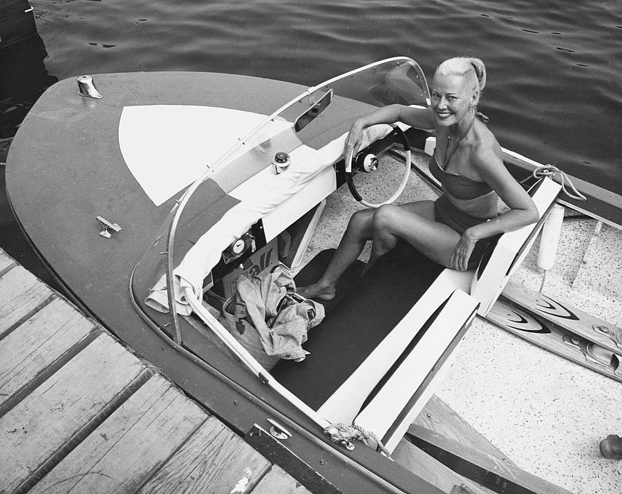 Adult Photograph - Woman In Speed Boat by George Marks