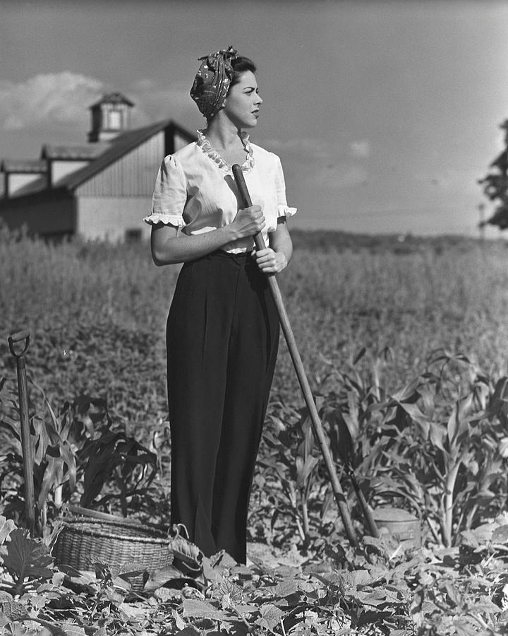 Adult Photograph - Woman In Vegetable Garden by George Marks