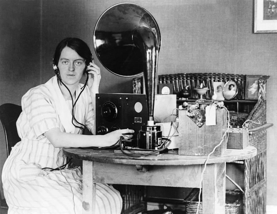 Woman listening to radio in her home photograph by everett for Listen to house music