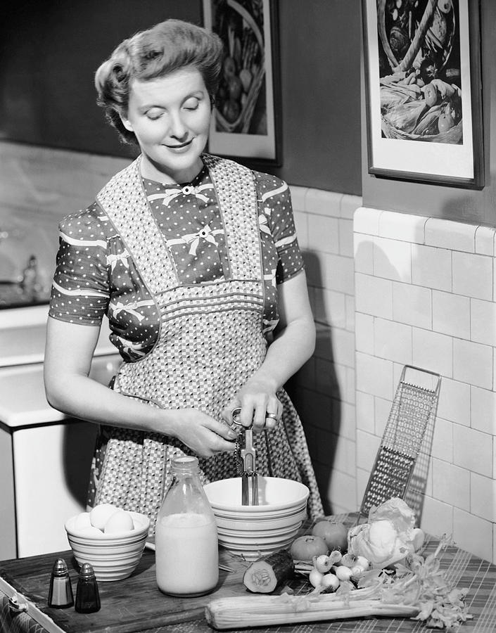 Adult Photograph - Woman Mixing Ingredients In Bowl by George Marks