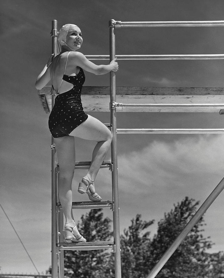 Adult Photograph - Woman On Diving Board by George Marks