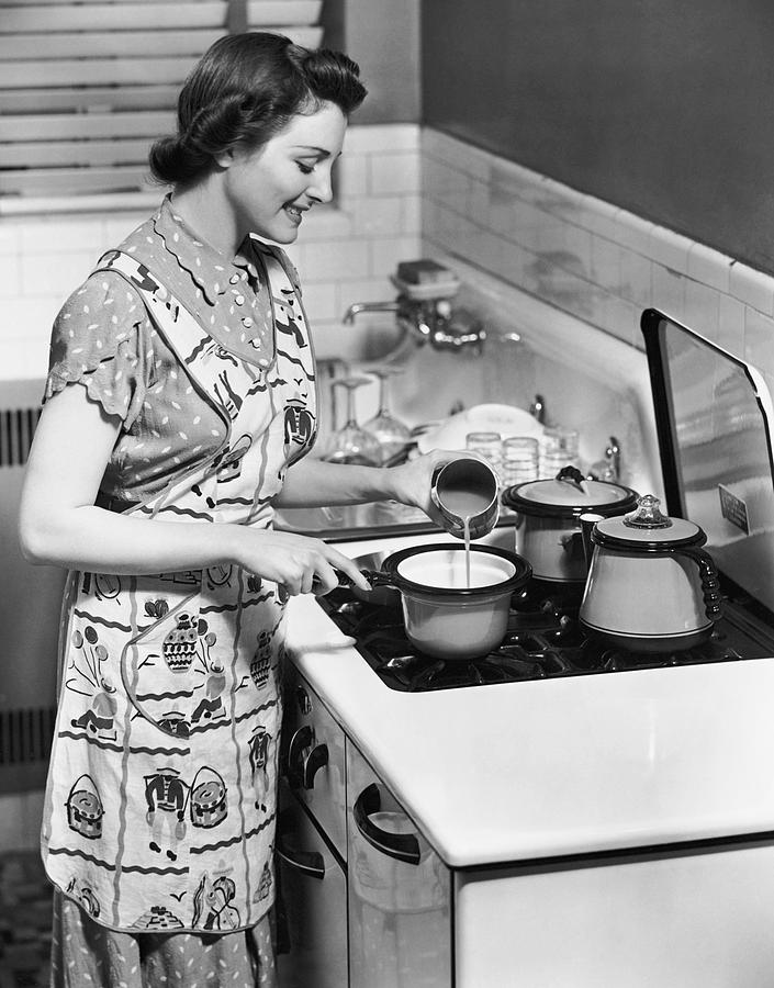 Adult Photograph - Woman Preparing Food On Stove by George Marks