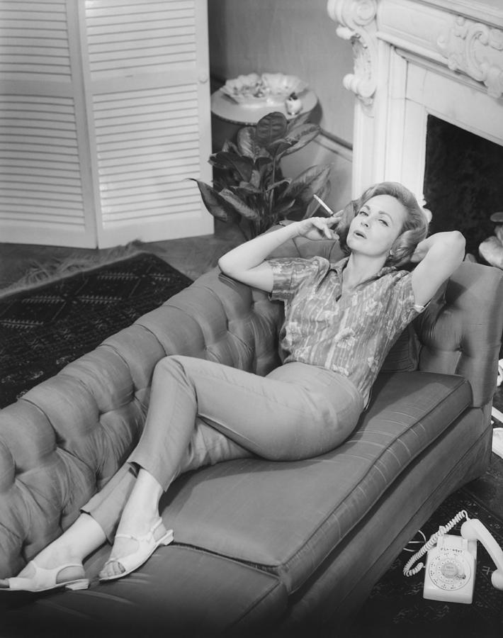 Adult Photograph - Woman Relaxing On Sofa, (b&w), Elevated View by George Marks
