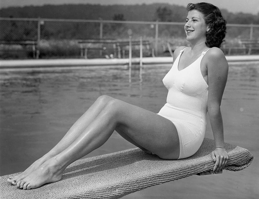 Adult Photograph - Woman Sitting On Divingboard by George Marks