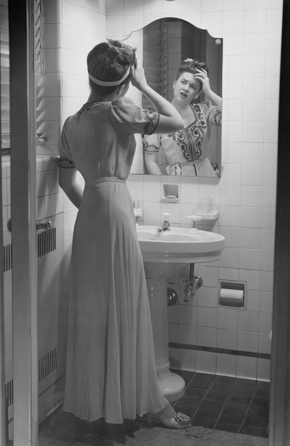 Adult Photograph - Woman Suffering Headache Standing In Front Of Bathroom Mirror, (b&w) by George Marks