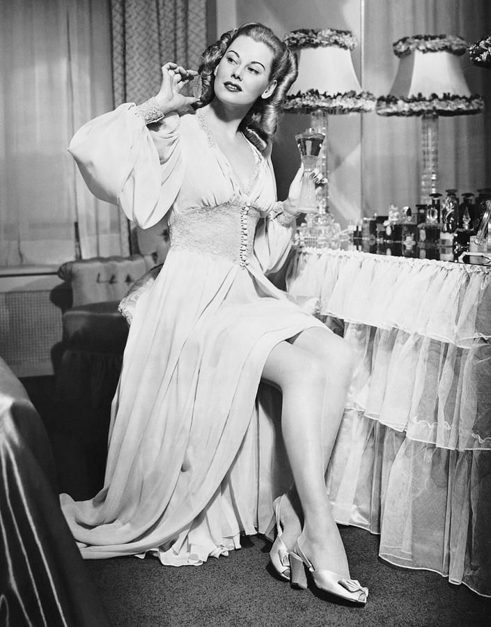 Adult Photograph - Woman W/ Bottle Of Perfume by George Marks