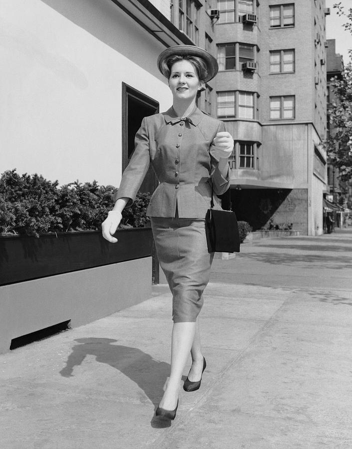 Adult Photograph - Woman Walking Down Sidewalk by George Marks