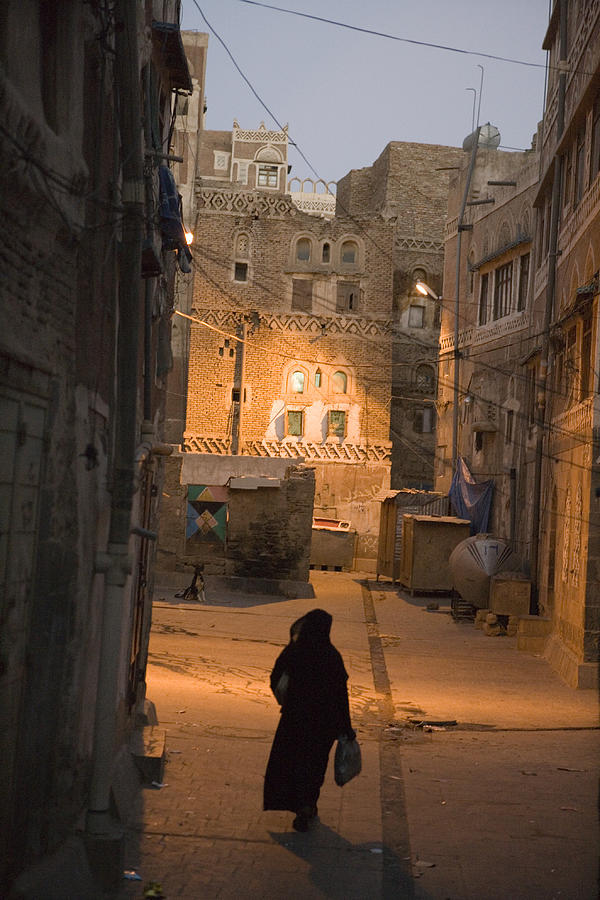 Woman Walking In Old Town, Dusk, Sana, Yemen, Middle East Photograph by Holger Leue