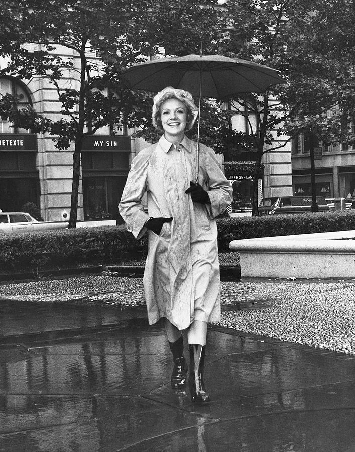 Adult Photograph - Woman Walking In Rain by George Marks