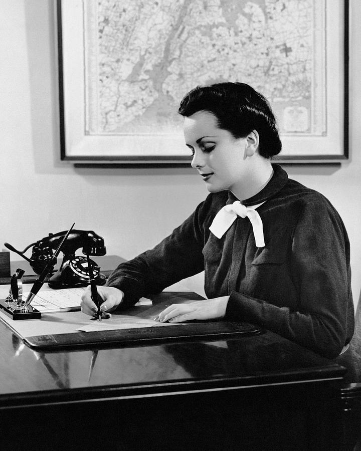Adult Photograph - Woman Writing At Desk by George Marks