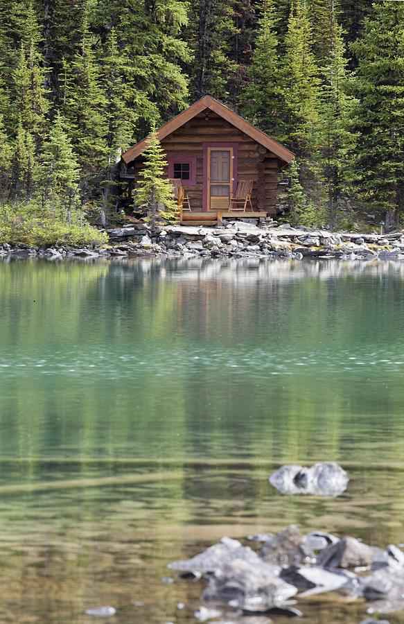 Cabin Photograph - Wooden Cabin Along A Lake Shore by Michael Interisano
