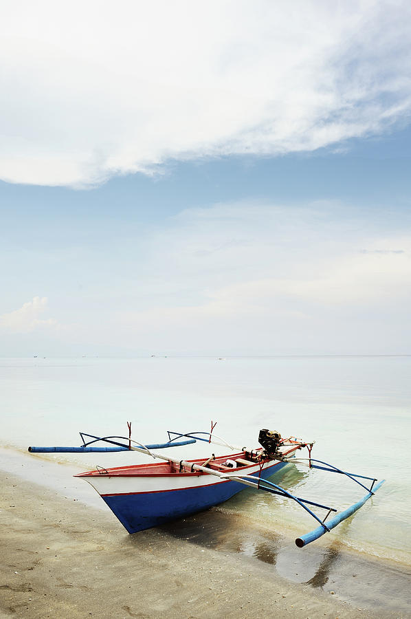 Vertical Photograph - Wooden Outrigger Boat On Shore by Carlina Teteris