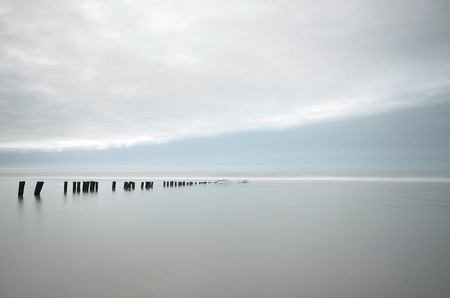 Horizontal Photograph - Wooden Stakes In Sea by Amk