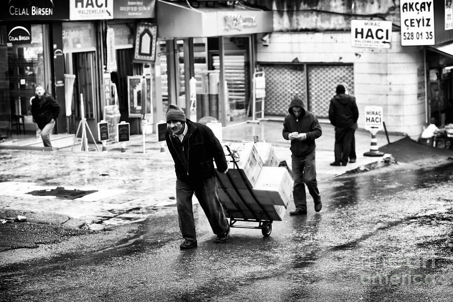Man Photograph - Working In Istanbul by John Rizzuto