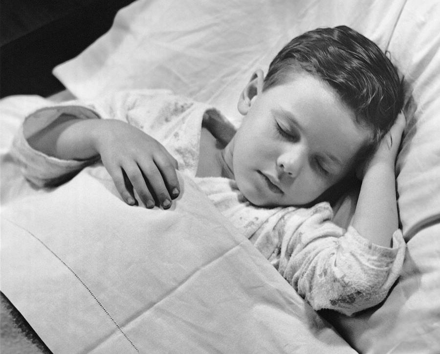 Child Photograph - Young Boy Asleep In Bed by George Marks