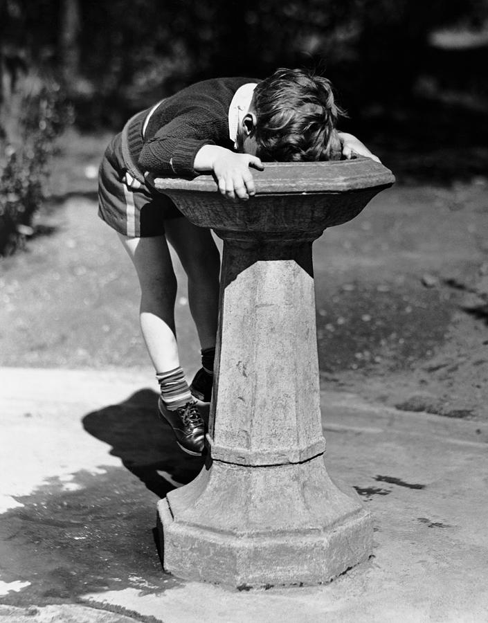 Child Photograph - Young Boy Drinking From Water Fountain by George Marks