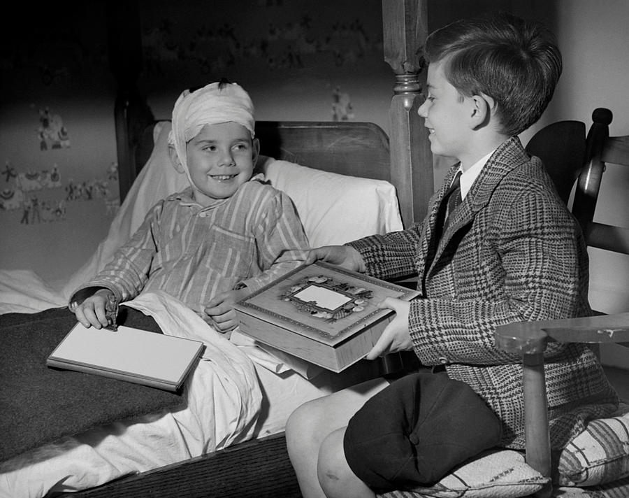 Child Photograph - Young Boy Visiting Sick Friend by George Marks