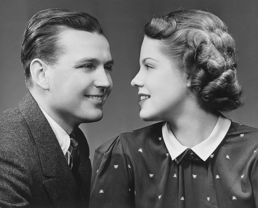 Adult Photograph - Young Couple Looking In Eyes In Studio, (b&w), Portrait by George Marks