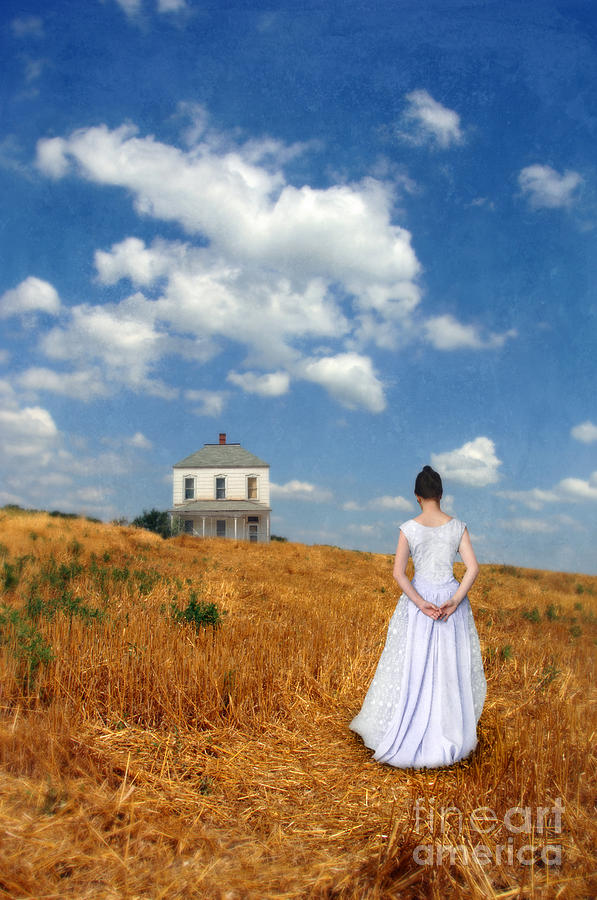 Young Lady In Wheat Field Looking At A Farmhouse