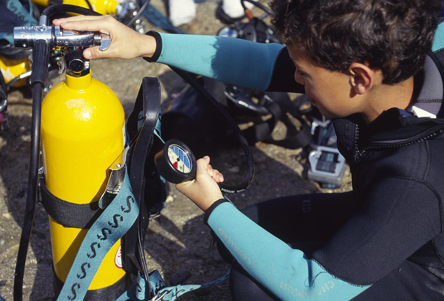 Diver Photograph - Young Scuba Diver Checking Kit by Alexis Rosenfeld