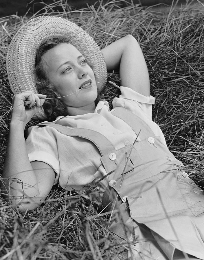 Adult Photograph - Young Woman Laying In Hay Thinking by George Marks