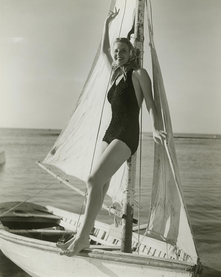 Adult Photograph - Young Woman Posing On Sailboat by George Marks