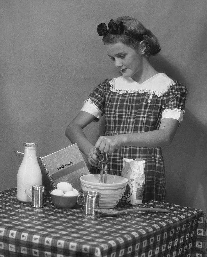 Teenager Photograph - Young Woman Preparing Food by George Marks