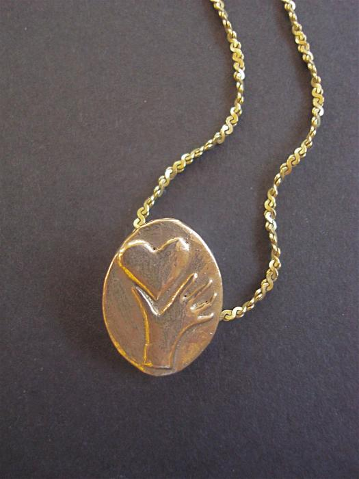 https://images.fineartamerica.com/images-medium/heart-in-hand-pendant-cydney-morel-corton.jpg