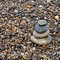 Cairn On Wet Pebbles by Diane Macdonald