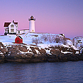 Nubble Light Under A Pastel Winter Sky by Jeff Sinon