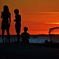 Perfect Ending - 3 Friends On A Pier As The Hot Summer Sun Sets On The Indian River Bay by William Bartholomew