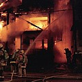 071506-4 Cleveland Firefighters On The Job by Mike Davis
