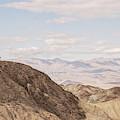 A Hiker Stands On A Peak by Chris Bennett
