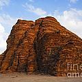 A Landscape Of Rocky Outcrops In The Desert Of Wadi Rum In Jordan by Robert Preston