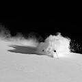 A Male Skier Skis Through Deep Powder by Mark Fisher