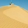 A Man Sits Atop A Dun In The Namib by Jen Judge