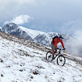A Mountain Biker Rides Through The Snow by Menno Boermans